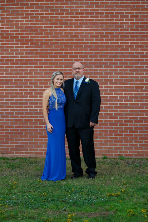 Sloan and her father before the event on October 5.