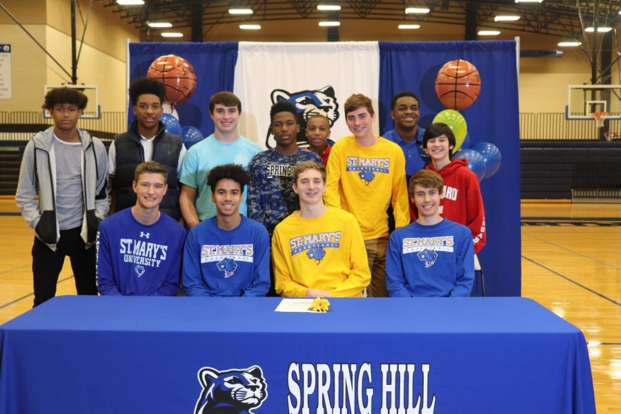 Tyler+Caron+celebrates+his+signing+with+St.+Mary%27s+University+to+play+Basketball+next+Fall