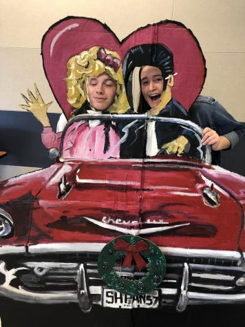 Bryce Wallce and Kelsey Darby have a Rocking Good Time serving others as members of the Leader's Core in a great photo prop made by Mr. Dunn, art teacher