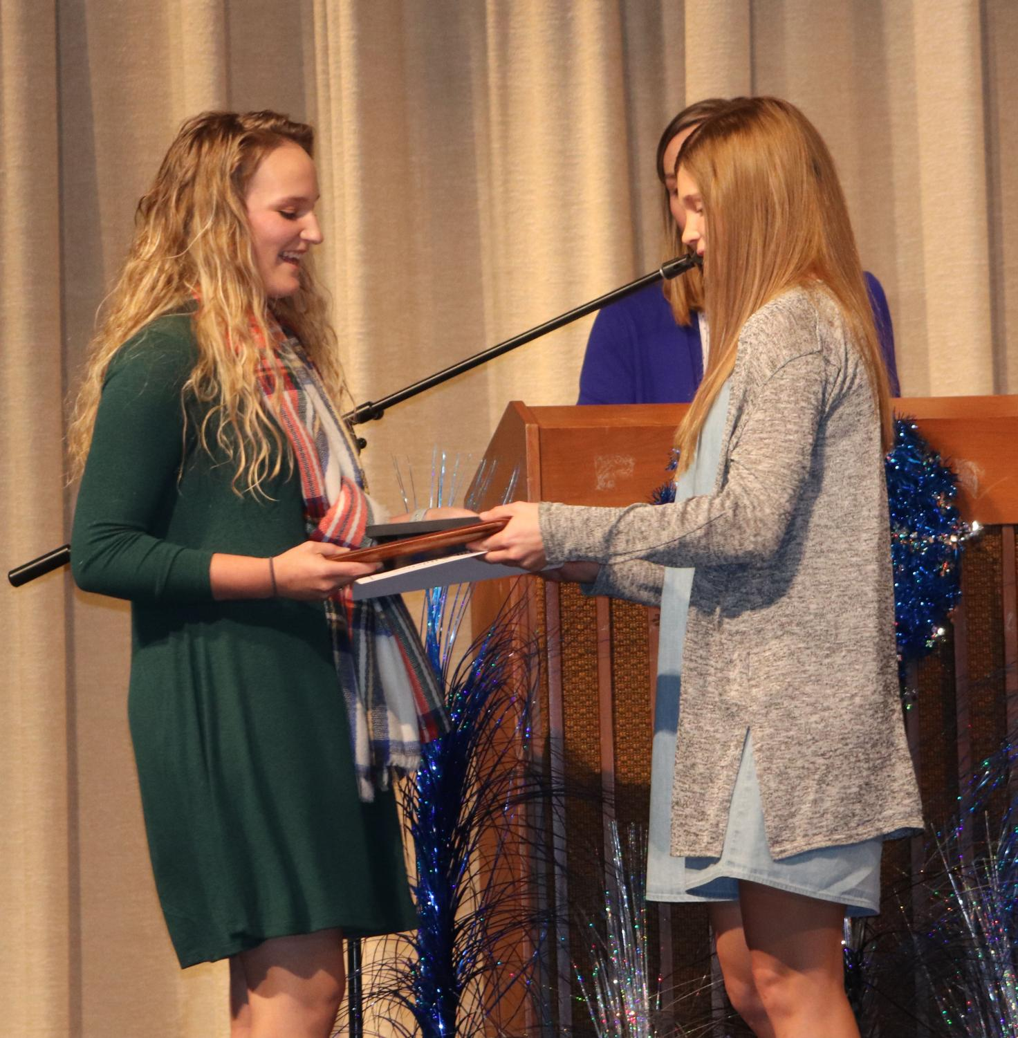 Coach White honors Samantha Schott on December 16 at the Fall Sports Banquet