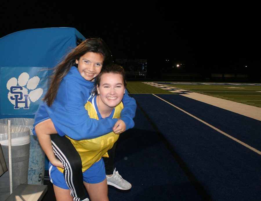 Raygan Barnhill and Anna Vizueth break from the action during last week's soccer game