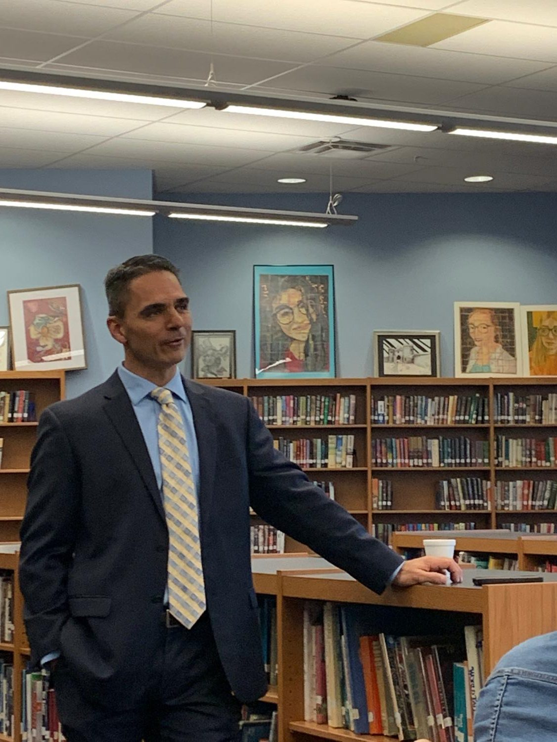 Dr. Guidry addresses faculty on April 3, 2019 in library