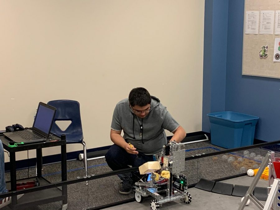 Jakob Zaricor uses a cell phone to collect data for the programer