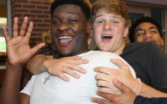 Malik Cook and Gage White cheer on state competitors at Monday's Send Off Rally