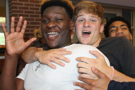 Malik Cook and Gage White cheer on state competitors at Monday