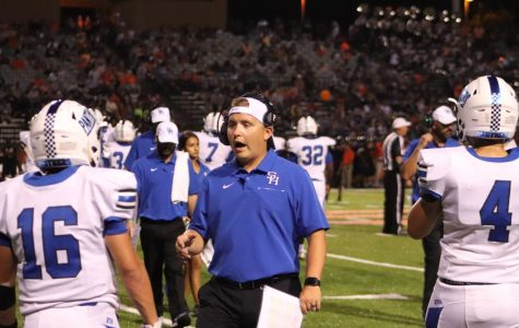 Coach Ladd encourages players on the sidelines during Gladewater opener