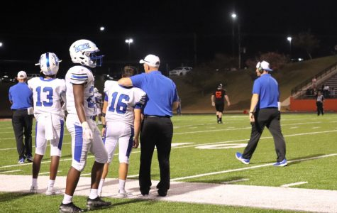 Coach Juneau encourages players during Gladewater game.