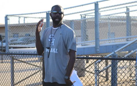 Coach Lewis smiles in the August heat as he prepares JH Panthers for competition.