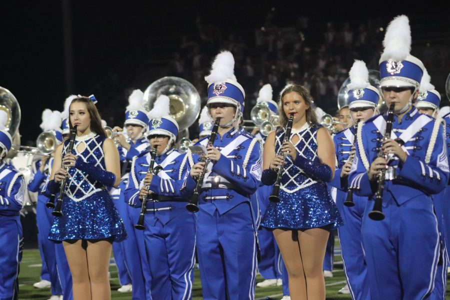 Gracie+Sist+and+fellow+clarinet+players+entertain+the+Panther+crowd+at+Panther+Stadium+at+the+home+opener.+