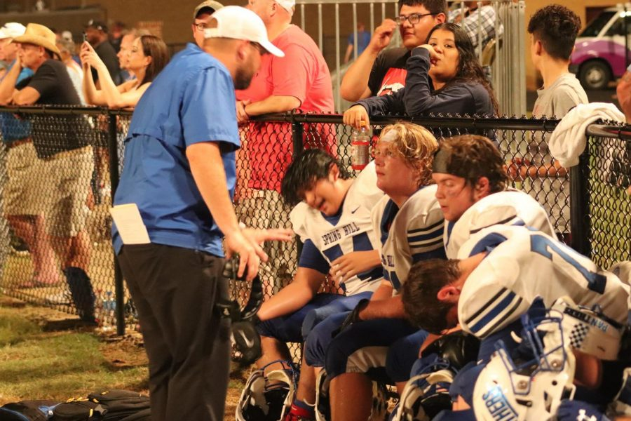 Coach Griffis communicates with the Panthers varsity offensive line as the game rolls on.