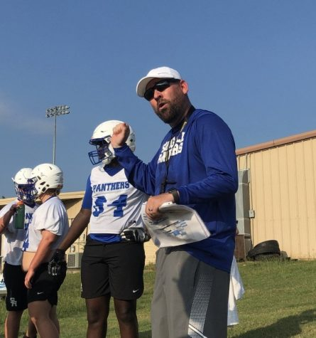 Coach Griffis molds athletes during morning practice.