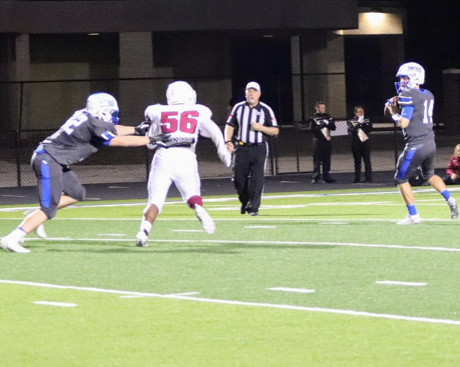 Gage Whites looks downfield for an open receiver during Friday, October 18 match against LE