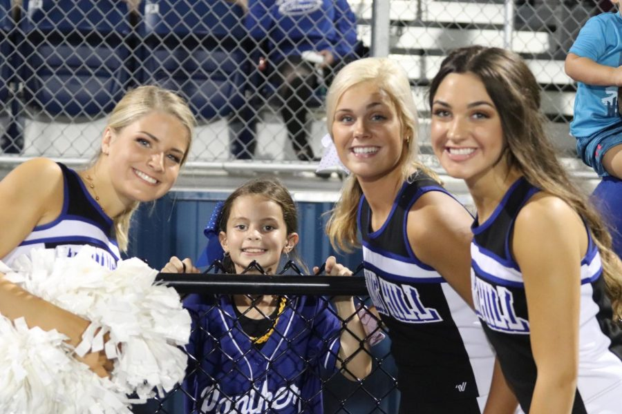 LExi Gossage, Peyton Dees, Ansley Nichols, and Zoe Gouzardi all smile for the camera at the homecoming game