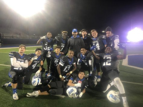 Spring Hill's senior football players and Coach Louvier celebrate making the playoffs for the first time since 2007 after winning their last district game against Pittsburg