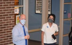 Principal Rusty Robinett and Vice Principal Melinda Tidwell smile behind their masks as students return to learn for 2020 and keep em covered during exams-