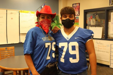 Amy Blalock poses with Dylan Murdick while wearing his jersey before the first varsity football game of the season.
