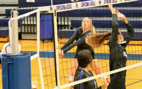 Freshman Carolann Bowles, bumps from the left side during the Varsity team's home game on August 22, 2020.