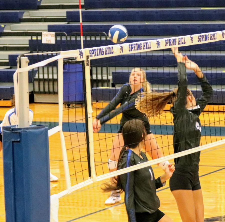 Freshman Carolann Bowles, bumps from the left side during the Varsity teams home game on August 22, 2020.