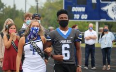 Sophomore Lindsey Hall is escorted by Curtis Crowe with the rest of the Duchesses at Friday's pep rally.