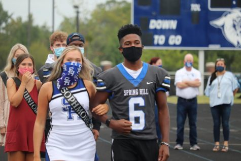 Sophomore Lindsey Hall is escorted by Curtis Crowe with the rest of the Duchesses at Friday