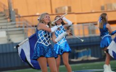 Junior Abbie Wallace stuns the crowd with twirls and tricks during halftime at Panther Stadium.