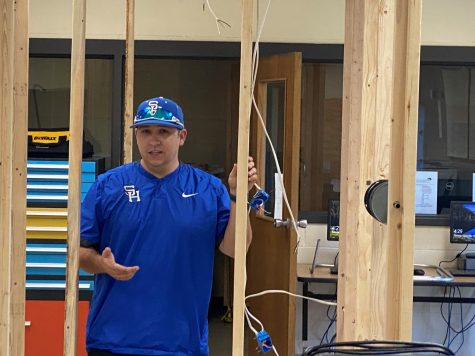 Tim Marshall stands in the housing frame model used for wiring in the Industrial Arts building on SHHS campus.