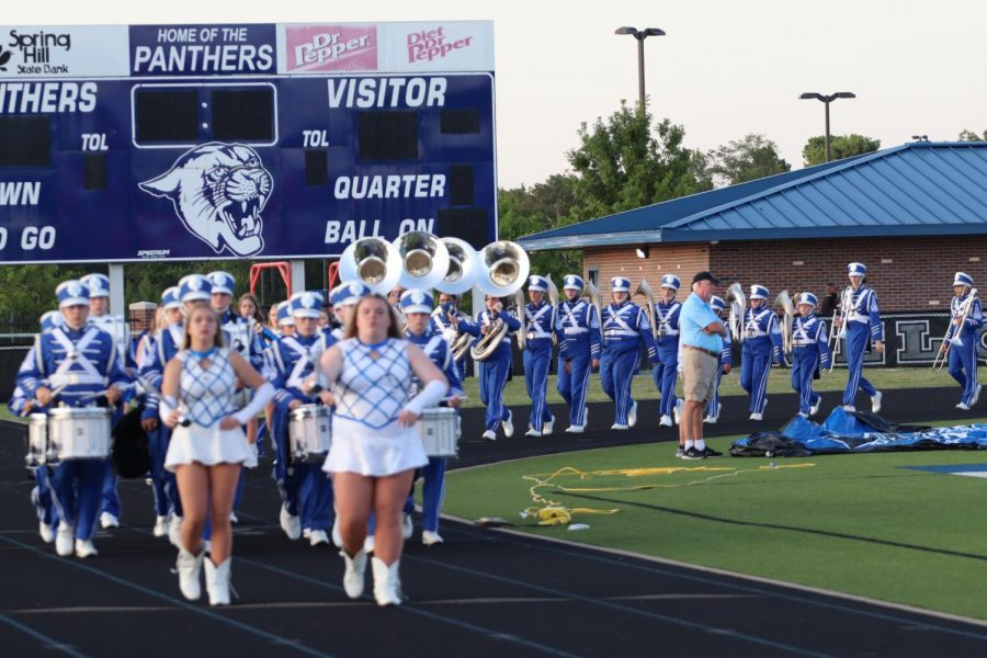 Senior Drum Majors Taylor Brewer and Rachel Petree lead the Blue Brigade to the visitors' side for a safe distance performance during the Community Nevada home game on September 11, 2020.