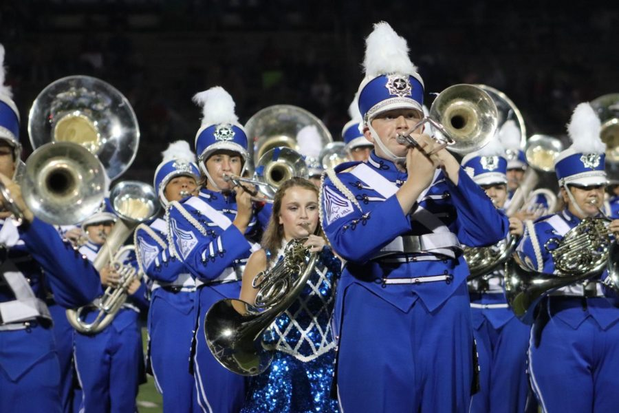 Thomas Pecot and other band members perform the fanfare on September 25.