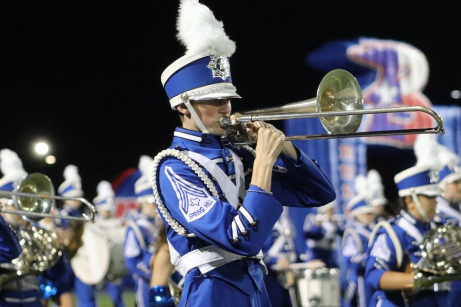 David McFatridge plays the trombone while marching the drill on September 25.