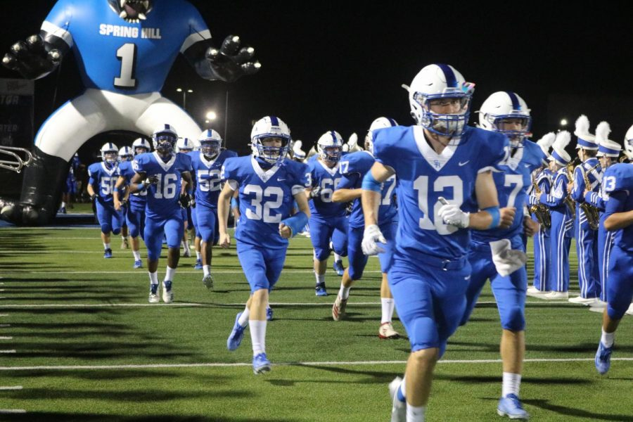 Spring Hill's Varsity Football team rushes on to the field ready to take on the opposition.