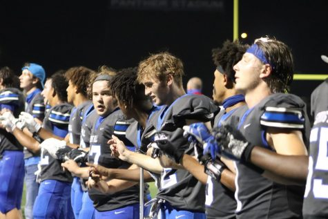 Varsity panthers stand for the playing of the spring hill school song after wining in OT against Bullard 27-24 at the  homocomming game September 25,2020