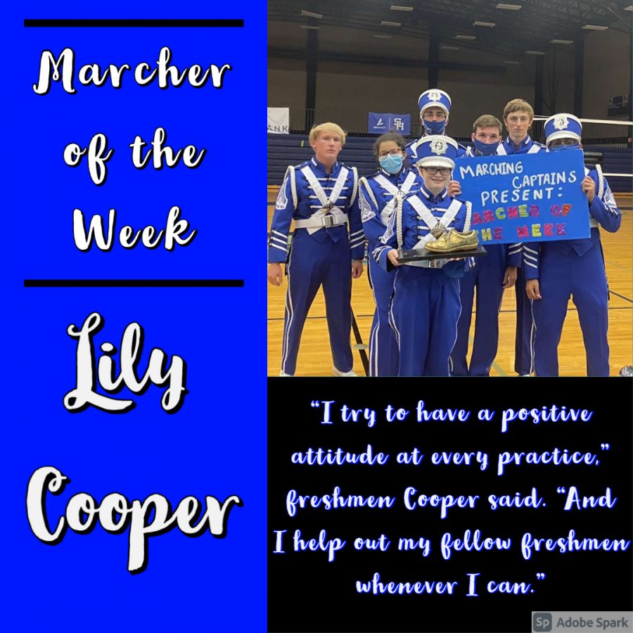 Lily Cooper and the Marching Captains pose for a picture as they present Marcher of the Week award on August 31.