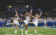 Pictures is Christina Thomas, senior,  Najah Jackson, senior, Julianna Jones, senior performing the arabesque on their home field for the Panther crowd.