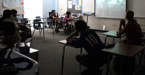 The History Club members watch a video in class to prepare for an activity.