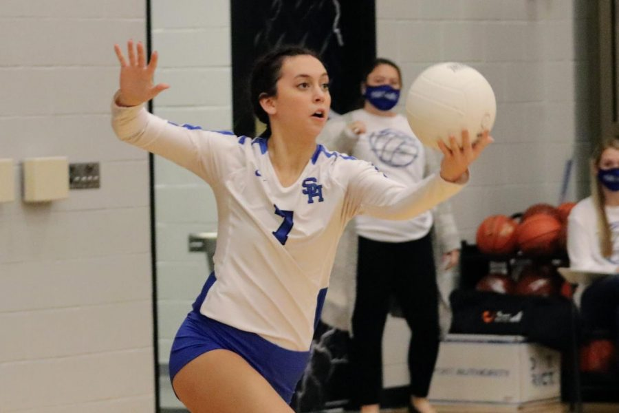 Erin Gregson, Junior, serves up an ace against Pleasant Grove in the BiDistrict Match in October