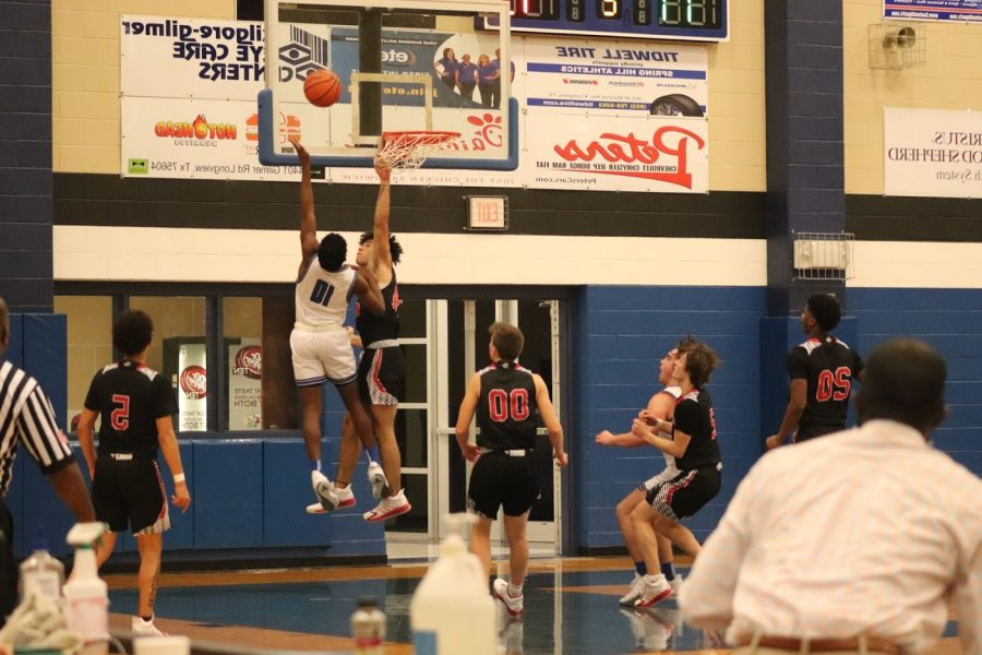 Senior Curtis Crowe attempts a layup against the Kilgore Bulldogs on the afternoon of January 11, 2021