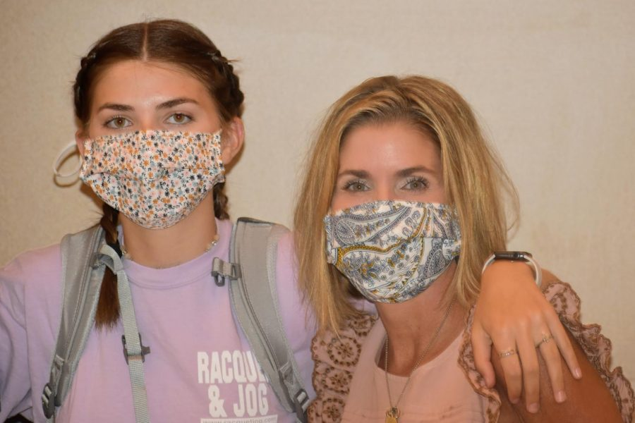Paige Childers and daughter, Addison, guide students by example, wearing masks and protecting others.