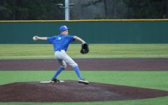 Baseball is in full swing, despite Basketball seasons late start of shared players and Pandemic quarantines. Freshman Andrew Grooters owns the mound, winding up for a strike at the Feb 8 scrimmage.