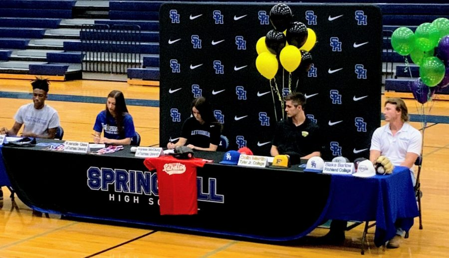 Five athletes sign a commitment to colleges for Fall on  May 4.