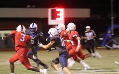 Senior Eric Morrow weaves through the Cardinals defense in the first regular season game last Friday in Sabine.