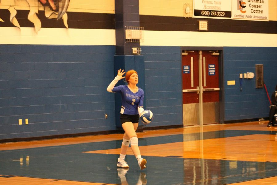 Senior Ashlyn Smith prepares to serve the ball against Van at home on 8/27.