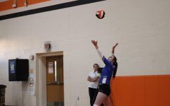 Junior Natalie Fisher serves the ball to the Elysian Fields Lady Yellowjackets in the non-district away game on 9/7