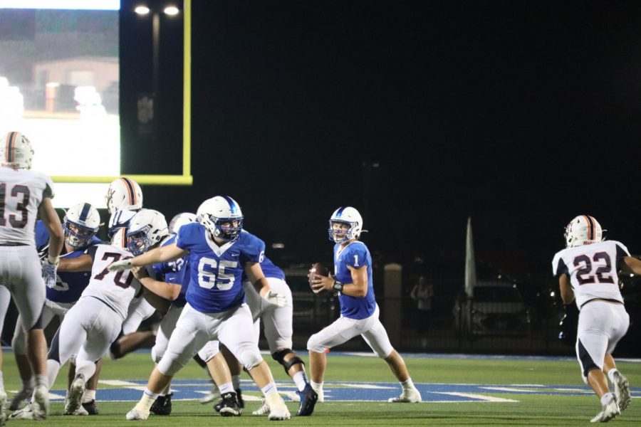 Junior Quarterback Jax Stovall scrambles out of the pocket looking for an open man to pass to down field during their game against Brook Hill last Friday.