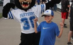 Penny Panther pumps her fists against the Roughnecks at Fridays Homecoming, September 10.