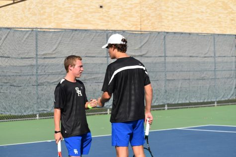 Seniors Zach Couch and Luke Hurst rally together during their tennis match against Kilgore, 9/28.